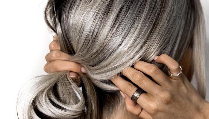 Почему седеют волосы в молодом возрасте: причины и что делать